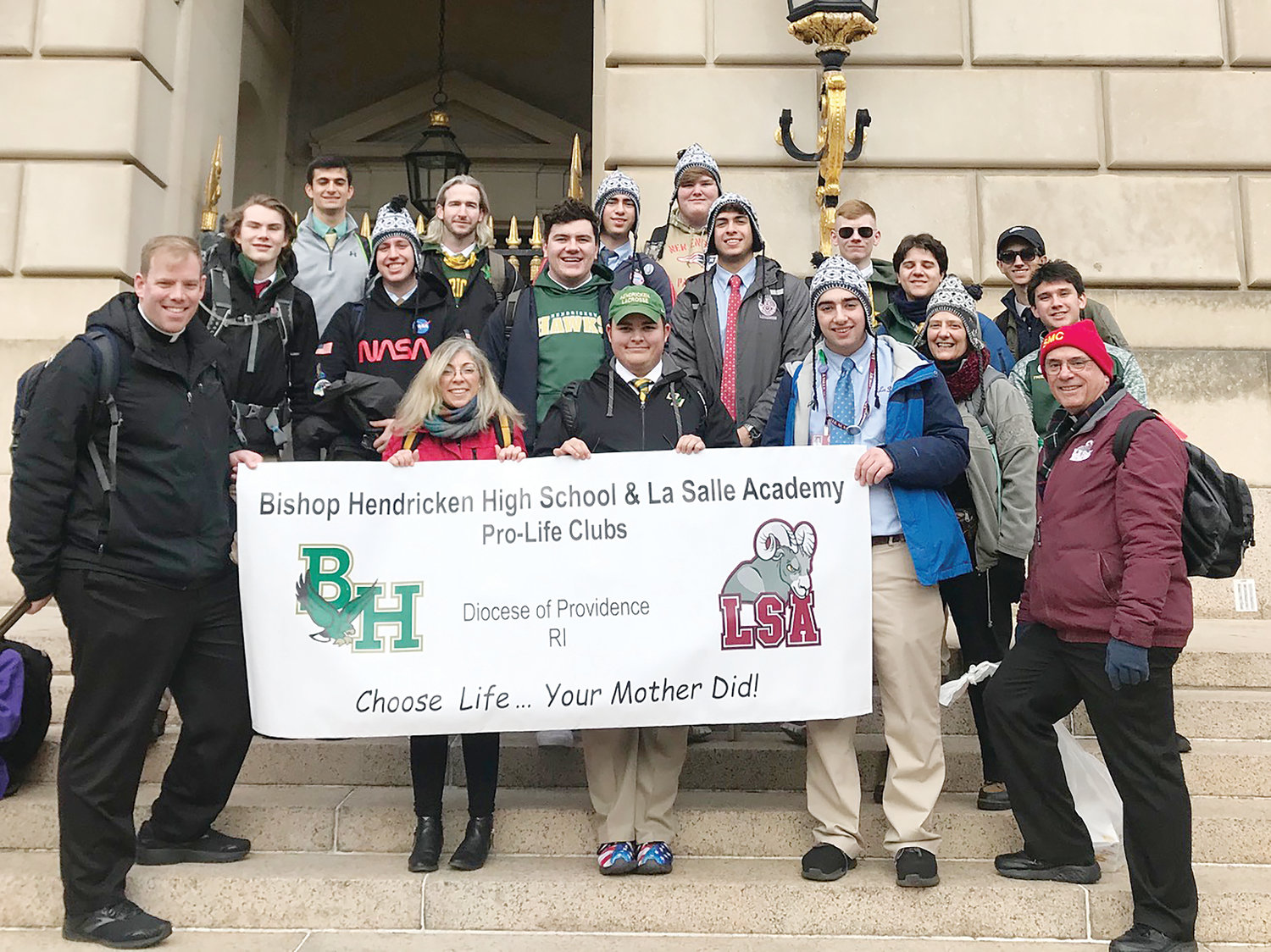 Pro-life groups from Bishop Hendricken High School and LaSalle Academy unite in Washington, D.C., for the March for life with their chaplains Father Brian Morris (Hendricken), left, and Father Thomas Woodhouse (LaSalle).
