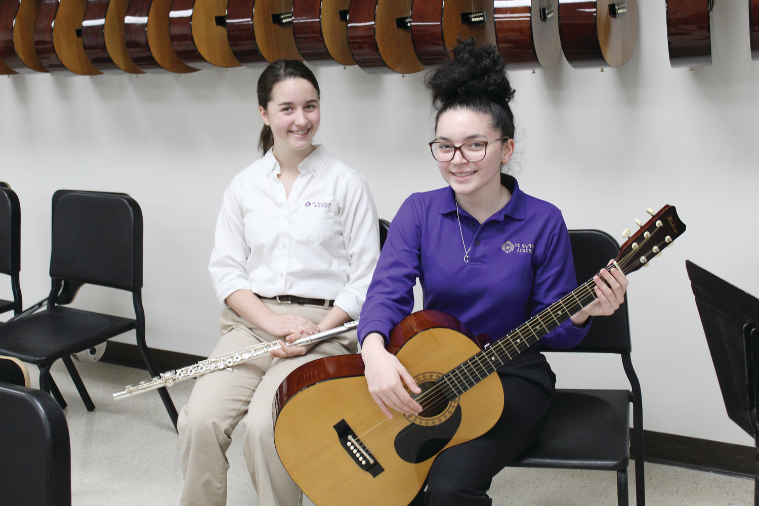 Two students from St. Raphael Academy in Pawtucket were chosen as All-State Musicians. Adelina Steinmetz, at left,  was selected to play flute in the senior division orchestra, and junior Camille Santos, was chosen for the senior division guitar ensemble.