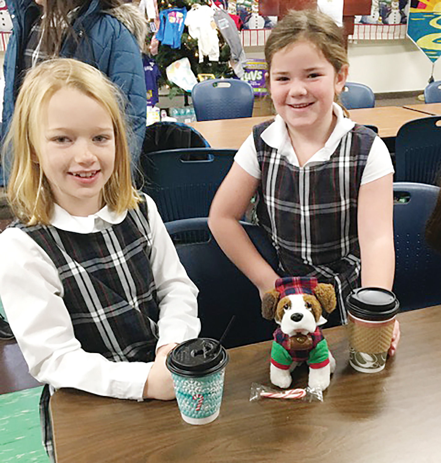 Second graders Michaela O'Connor and Skylar Murphy enjoy some cocoa.