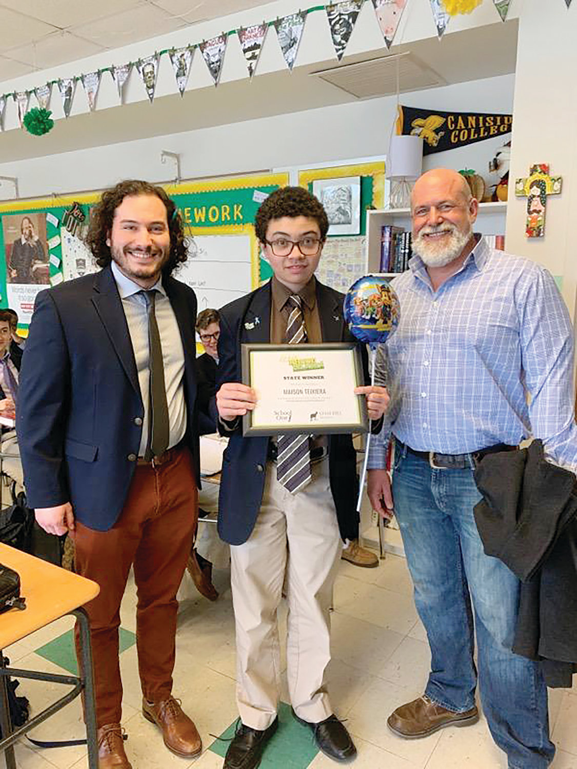English teacher Nick Tavares with Maison Teixeira and author Taylor Polites at Bishop Hendricken High School.