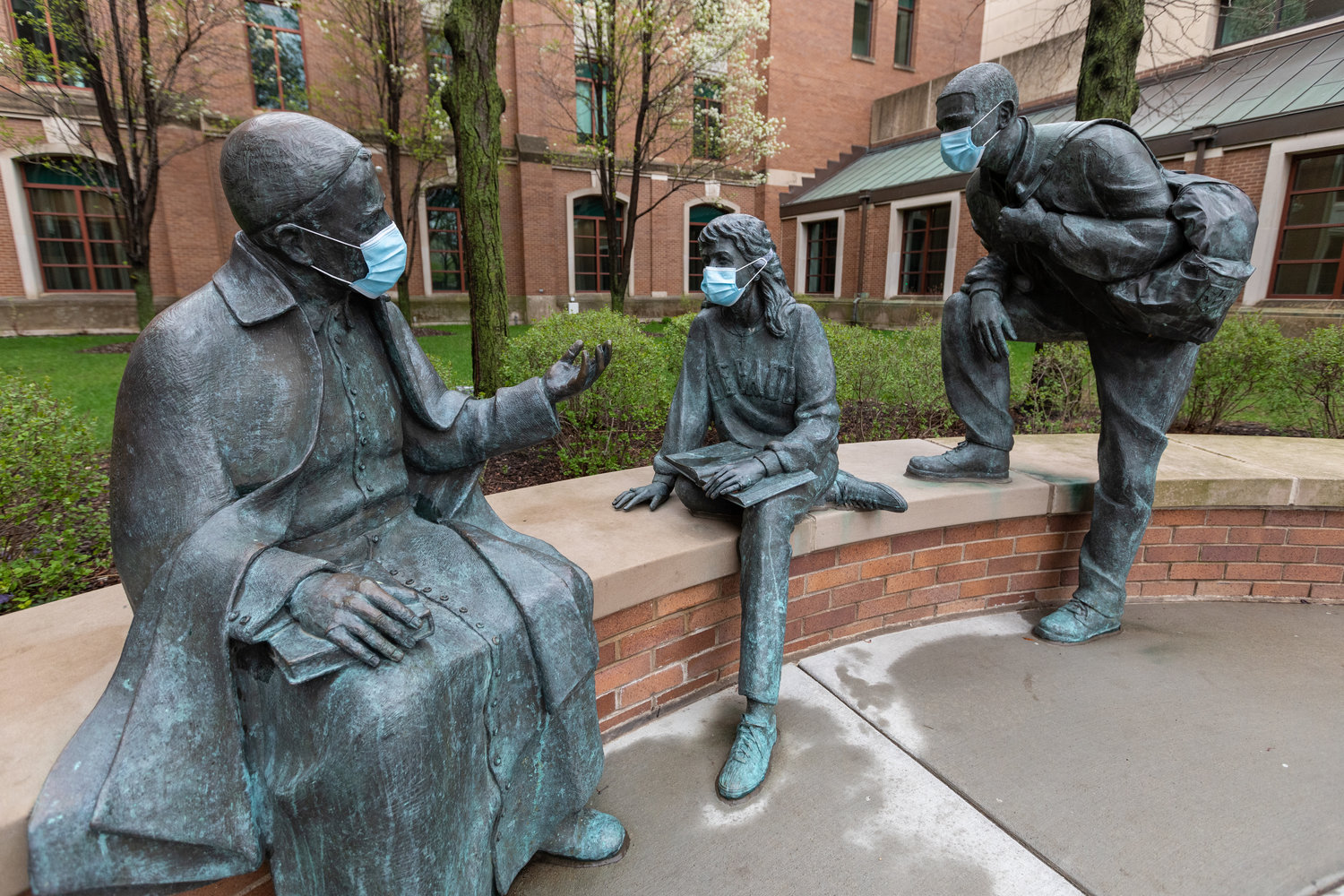 The statues in St Vincent's Circle on DePaul University's Chicago campus are decorated with protective face masks April 30, 2020, during the COVID-19 pandemic. School officials say extreme caution tops the checklists for Catholic colleges throughout the U.S. to reopen in the fall.