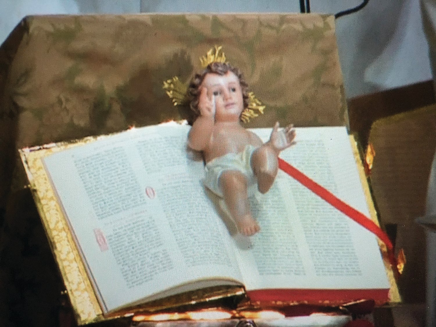 A figurine of the baby Jesus on Christmas morning.