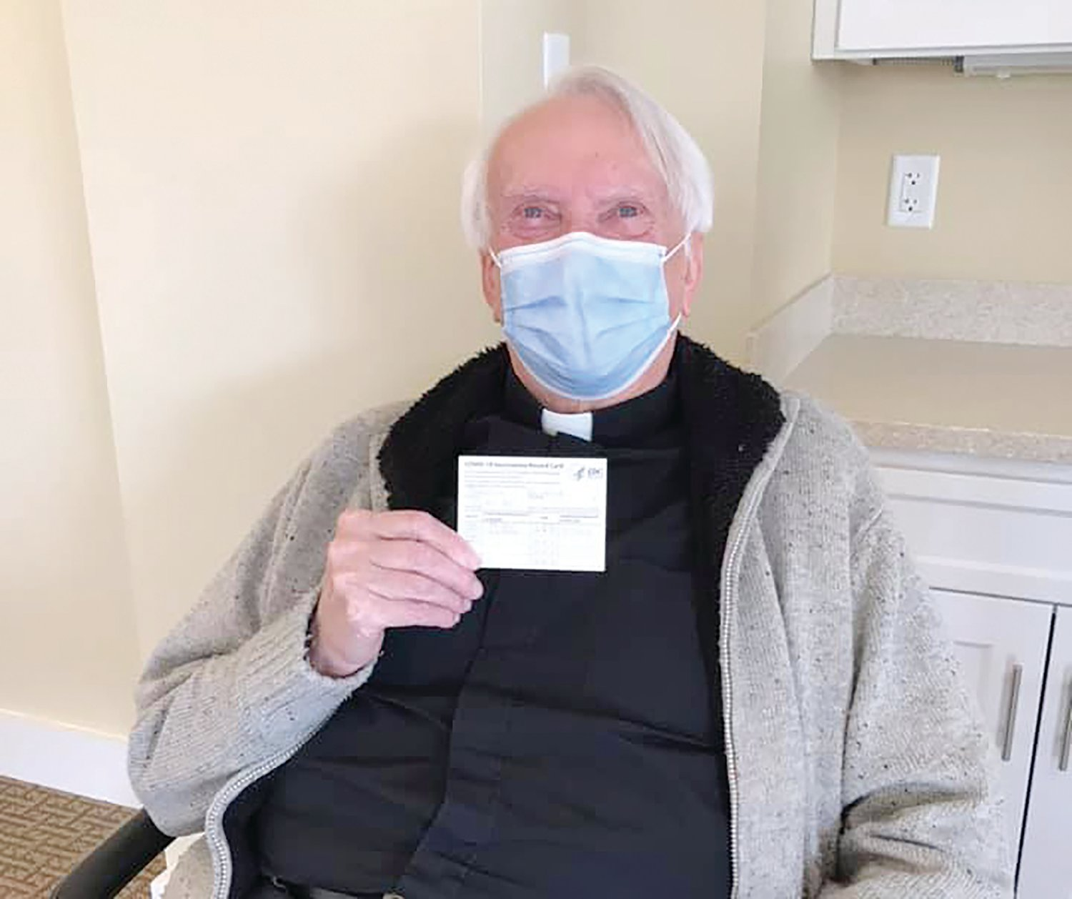 On January 8, CVS visited St. Clare-Newport to administer the first round of vaccines for residents and staff. Pictured with documentation of the shot is Father Ray Theroux.