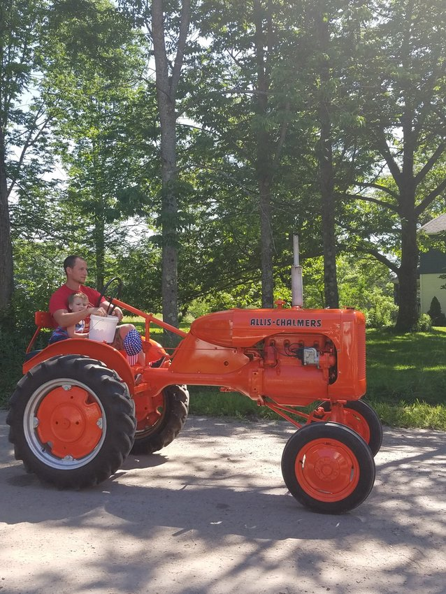A vintage mid-sized Allis Chalmers rolls by, one of Grandpa's favorites.