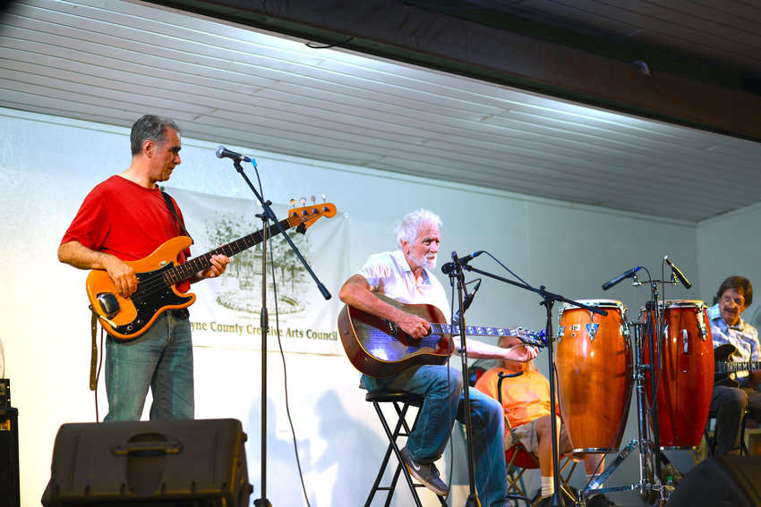 Bob Tellefsen performing in Honesdale with Chip Forelli on bass, Kenny Christianson on conga and Tony Maddi on electric guitar