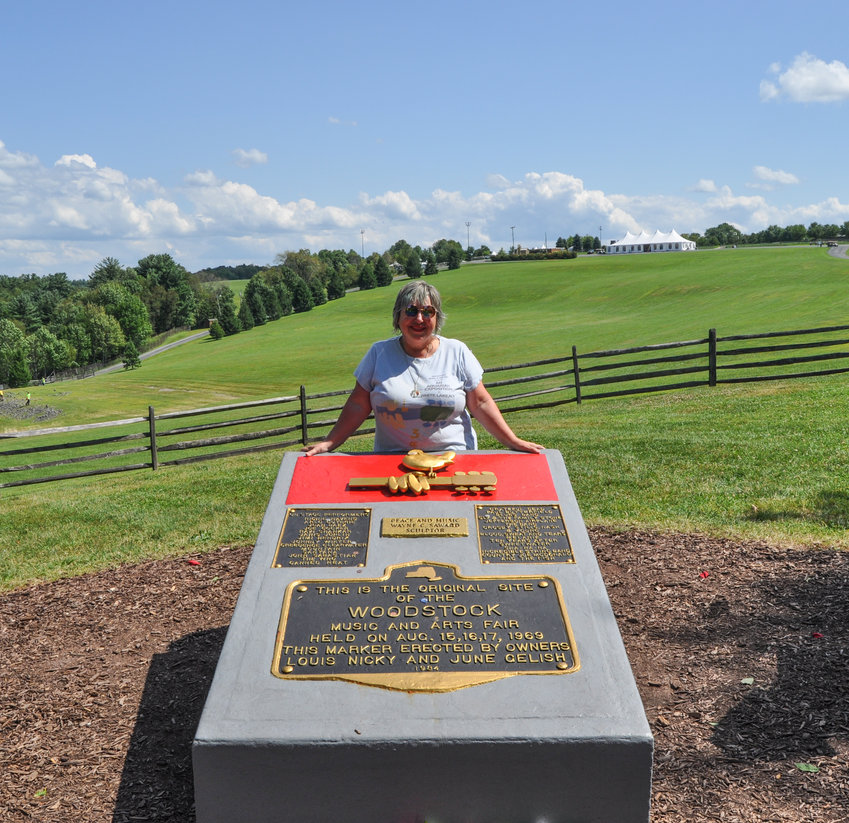 Visiting-friend Kelli with the Woodstock memorial.