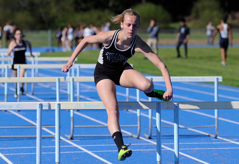 TRR photo by Ted Waddell  Sam Becker in action on May 8, as she won four events in the track and field dual meet against John S. Burke.