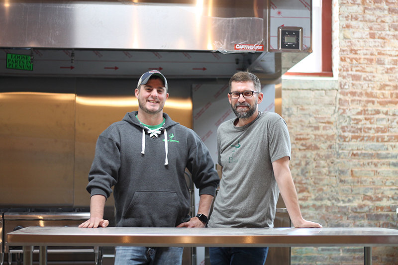 Old college friends Jason Nacinovich, left, and Chris Tuleya at the under-construction Hop Barons Kitchen in Honesdale.
