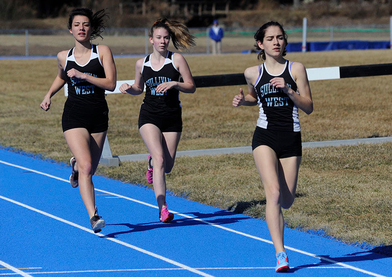 TRR photos by Ted Waddell  Competing in the 1500 meter race, Sullivan West's Tallula Gann, Laura Smith and Taylor Tyler