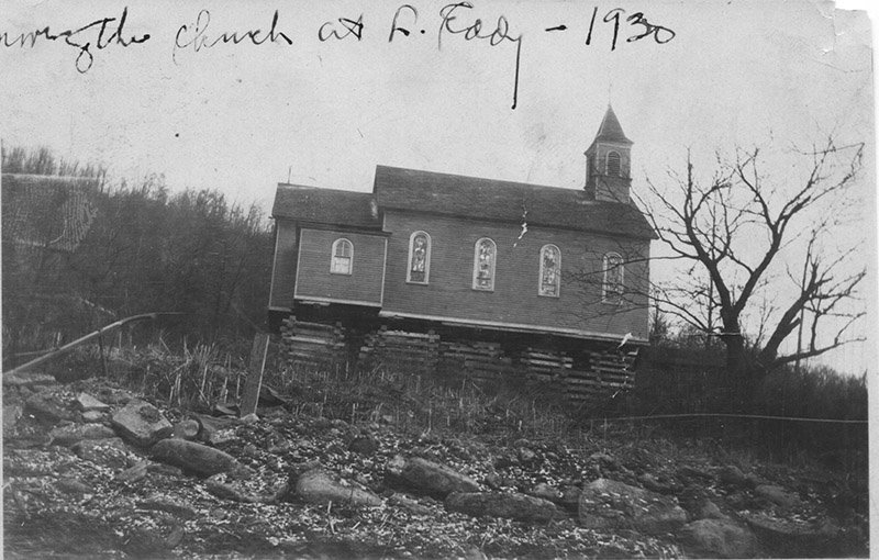 Photo provided by the Basket Historical Society.  Preparing the church for the move from the hillsideof McKoon Mountain to its current location on Church Street in Long Eddy.