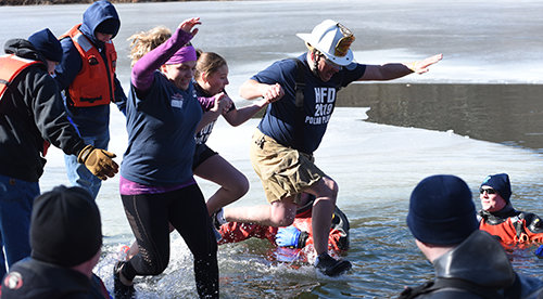 Alzheimer's Association Hudson Valley    Participants hold hands and brace for an icy dip.