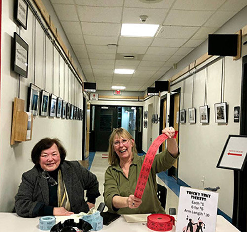 Photo from the chamber's Facebook page  Elaine Guguere, left, and Jill Padua sold tickets for the tricky tray during the event.