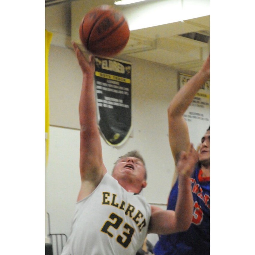 TRR photos by Ted Waddell    Maximum effort. Eldred's Chett Kelty goes to the rim.