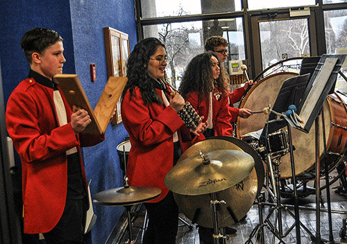 The percussion section provided sounds of horse hooves, sleigh bells and the occasional crack of the whip  at the Liberty High School Honors Band noontime concert at the Government Center in Monticello on Monday.