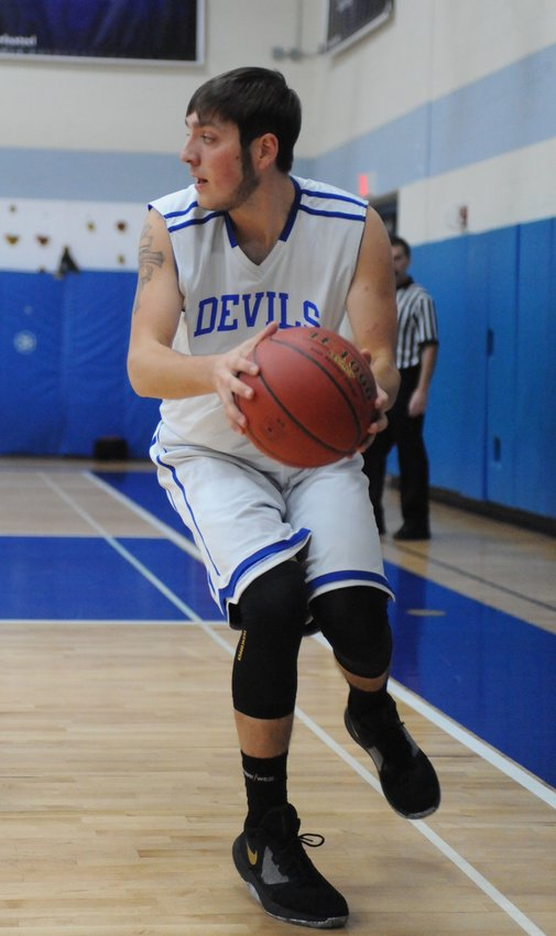 TRR photos by Ted Waddell    Rebounder. Roscoe's Ty Engle scored 12 points.