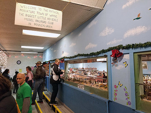 Photos by Joe Cooke      Visitors check out the Stourbridge Lion Model Railroad Club display and talk to club members.