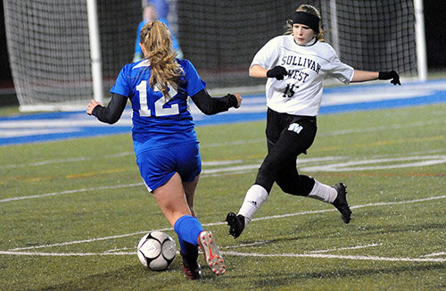 TRR photos by Ted Waddell      Blitzkreig: Millbrook's Rebecca Quick makes a lightning-fast attack, as Sullivan West's Jenna Kratz defends.