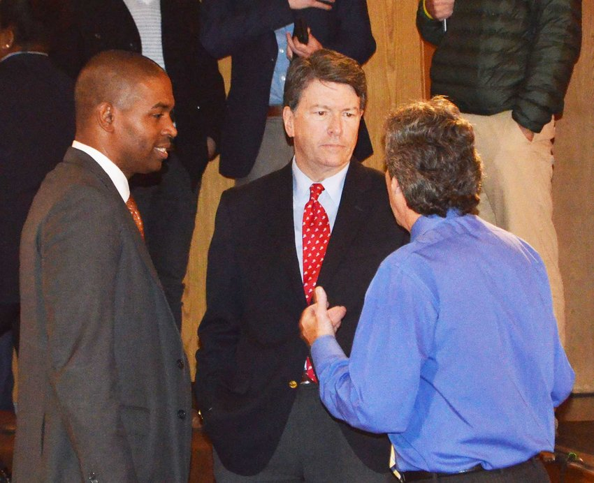 TRR photo by Fritz Mayer      Democratic Candidate Antonio Delgado, left, and Republican incumbent John Faso chat with moderator Barry Lewis before a debate at SUNY Sullivan October 29.
