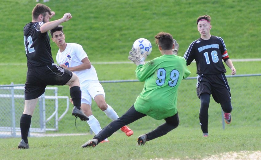 TRR photos by Ted Waddell      Almost! Sullivan West's ace-in-the-hole keeper Efrain Martinez makes a mighty effort at deflecting a successful shot of goal by Seward's Tommy Bracken. Bulldogs Evan McCombs and Nick Dworetsky are in on the action.