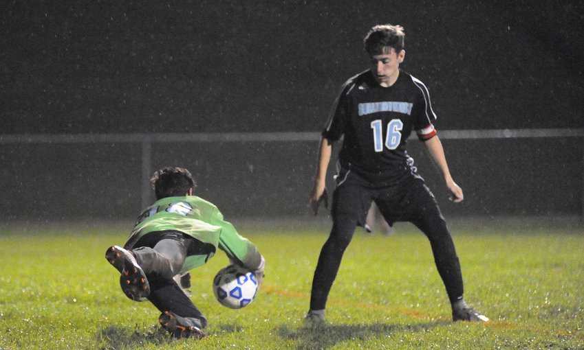 TRR photos by Ted Waddell      Savior! Sullivan West's ace-in-the-net goalie Efrain Martinez makes a diving save of a blistering shot on goal, as teammate Nick Dworetsky watches.