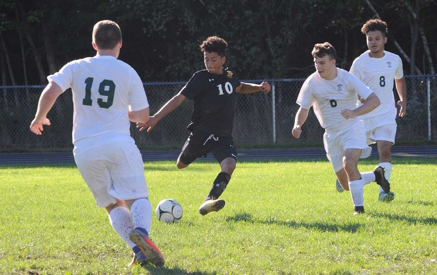 TRR photos by Ted Waddell      Shot on goal! Fallsburg's Jonathon Lagos lines it up, as Eldred defenders Brian Sherwood, Jordan Reed and Matthew Bieler try to cut him off at the pass.