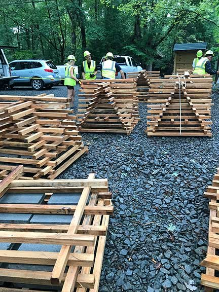 Contributed photos      Volunteers constructed 20 porcupine cribs to be placed in Lake Wallenpaupack to improve fish habitat. As seen at the bottom left, cement blocks were added at the base of each structure to keep it submerged.