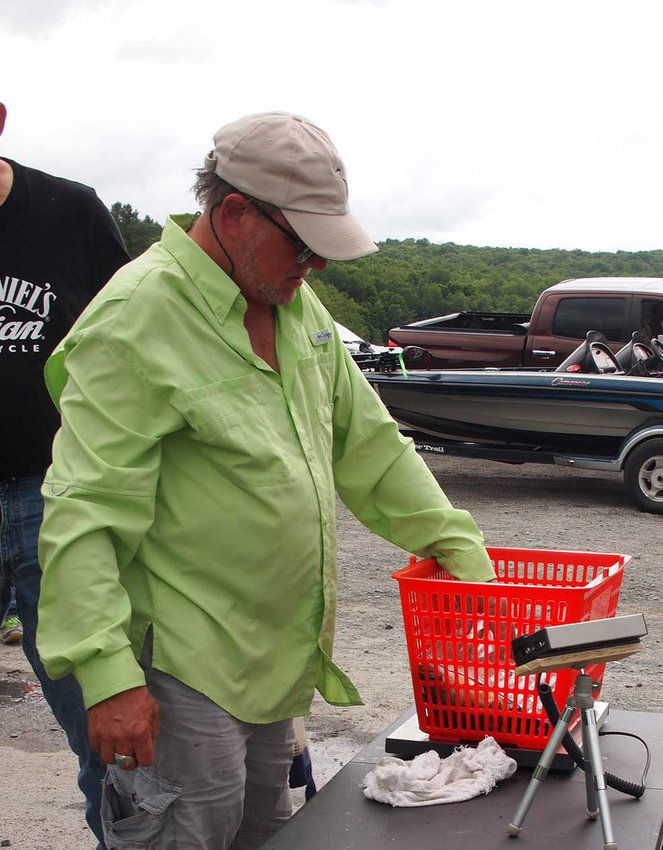 TRR photo by Hunter Hill      Jonathan Sunshine is seen here weighing fish as competitors return to the launch.