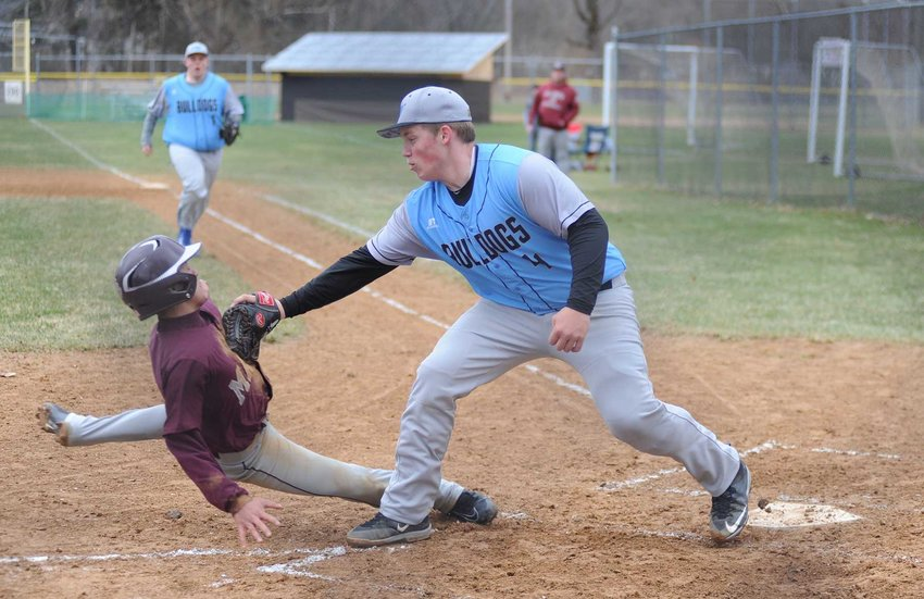 TRR photos by Ted Waddell    Out at home: Sullivan West's winning hurler Bryce Reimer tags out Manor's Peter Pagan at the plate, as teammate first baseman Brandon Dailey closes in on the action.