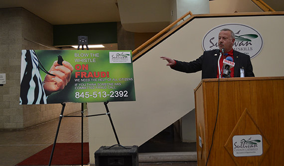 Joe Todora, commissioner of the Sullivan County Division of Family Services, unveils a hotline number encouraging residents to report welfare fraud should they be aware of any.