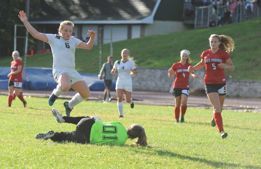 Attack mode: Eldred's Lenae Kelty leaps over Liberty's keeper Gabriella Magie, as she reels in a shot on goal.