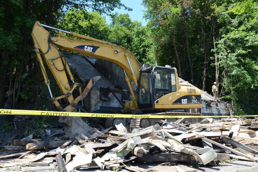 The vacant coal pocket building on Commercial Street in Honesdale was demolished after being badly damaged in a fire.