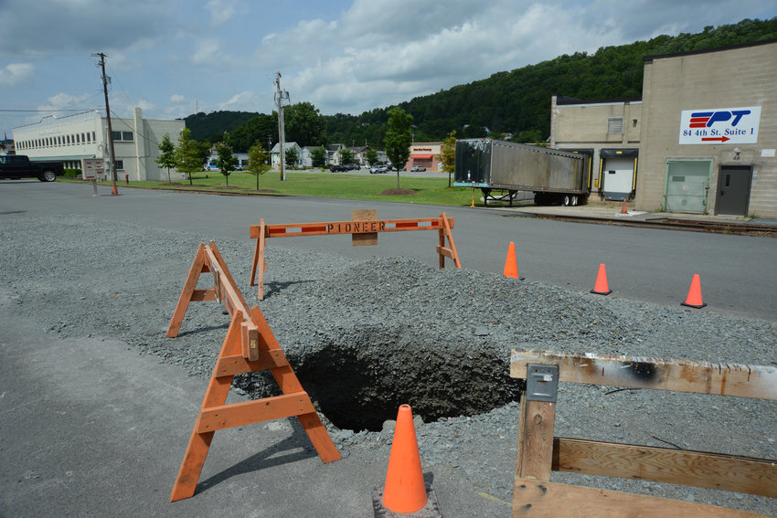 DPW recently repaired another sink hole in Top Notch Distributors parking lot, like this one from 2019. Councilor Bill Canfield said the parking lot has similar issues every year.