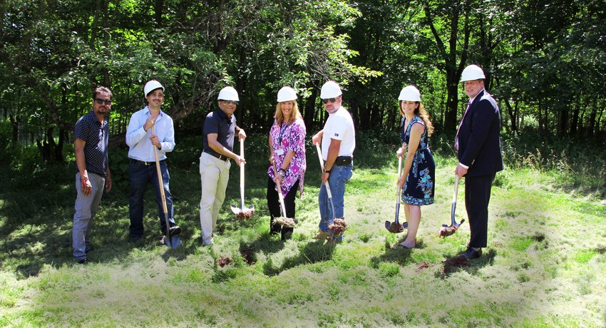 Parag Patel, left, is joined by Louis DiCostanzo of Sonny Patel's team; developer Sonny Patel; New Hope Community Chief Executive Officer Debra J. McGinness; Morris Schrader of Sonny Patel's team; New Hope Community Board Chair Juliette P. McKerrell; and New Hope Community Assistance Vice President of Program Operations Terence Duncan break ground at the Monticello property, a major step toward the New Hope-Sonny Patel partnership of building three, three-story building ADA-compliant apartment complex.