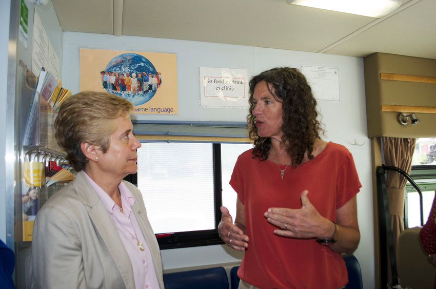 Dr. Cecilia Escarra chats with Sen. Jen Metzger about the PRASAD Project, which provides dental services to children in Sullivan County.