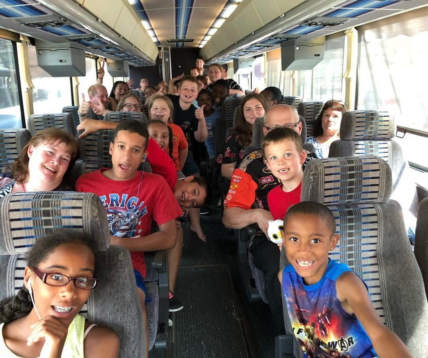 Twenty-five children and their parents travel to New York City to visit the USS Intrepid Sea, Air and Space Museum.