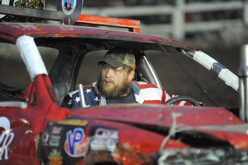 Red, white & blue. The driver of demo car #68 moments after winning a heat.