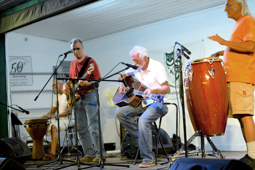 Michael Coppola, left, Chip Forelli, Robert Tellefsen and Kenny Christianson play to the crowd gathered in Honesdale's Central Park earlier this summer. Not pictured is Tony Maddi playing electric guitar.