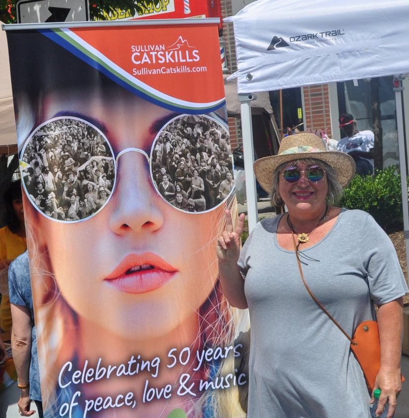 """Life-long pal Kelli fit right in with the Woodstock crowd wherever we went, including this stop at the fun-filled Bagel Festival in Monticello, NY—aka the """"Bagel Capital of the World."""""""