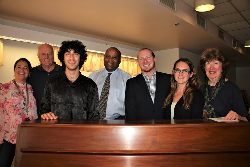 Care Center at Sunset Lake (CCSL) marketing and outreach coordinator Kristen Kitson, left, CCSL family council president Robert Konvalin, pianist Maxim Lando, CCSL administrator Frank Murphy, Shandelee Music Festival Youth and Outreach program director John Bernstein, CCSL activities director Miranda Page and Family Council treasurer Barbara Konvalin celebrate after Lando's concert for the clients of CCSL on August 16.