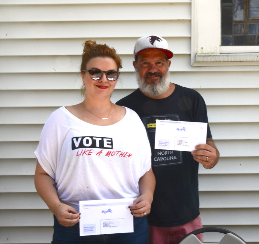 Amber Tamblyn and David Cross stopped attendees on Saturday morning at the Barryville Farmers' Market to ask if they were registered to vote.