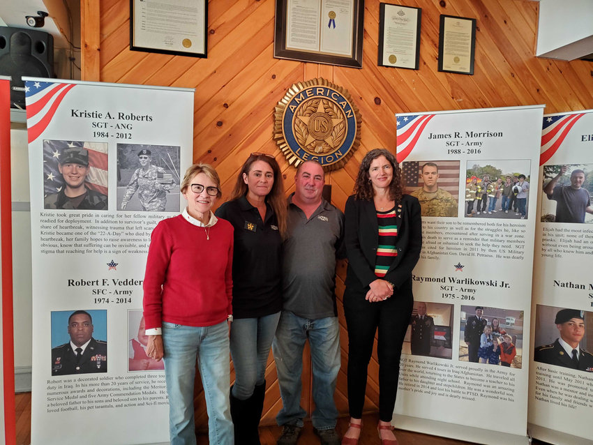 Assemblywoman Aileen Gunther, left, stands with Laurene Sandstrom, Michael Flower and Sen. Jen Metzger. Sandstrom and Flower are with the New York Warrior Promise Wall, a traveling memorial honoring the servicemen and women who have fallen to suicide
