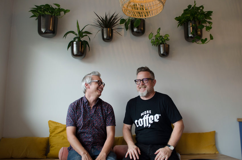 Artist and beekeeper Charles Wilkin, left, and coffee-roaster Martin Higgins sitting in their new café/workspace onv 104 Kirks Rd.