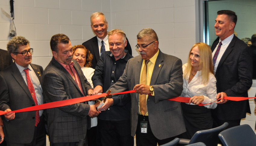 Sullivan County Chairman of Legislature Luiz Alvarez, center,  joined county legislators in the ribbon-cutting ceremony for the new state of the art Jail and Sheriff's administration facility in Monticello Thursday afternoon