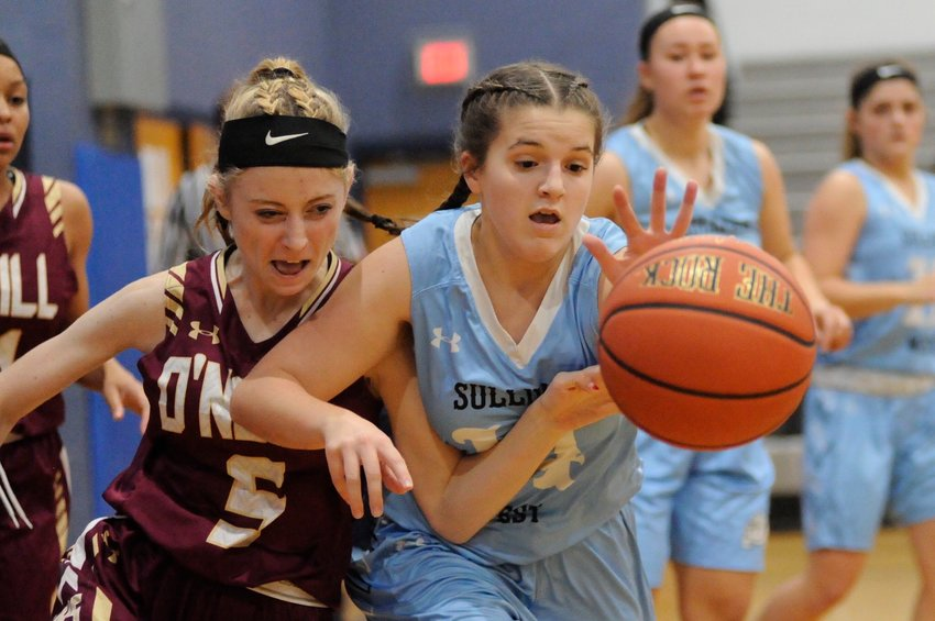 "Chasing ""The Rock"". O'Neill's Josey Arbogast and Sullivan West's Brielle Arnott show the intensity of the game as they battle for possession."