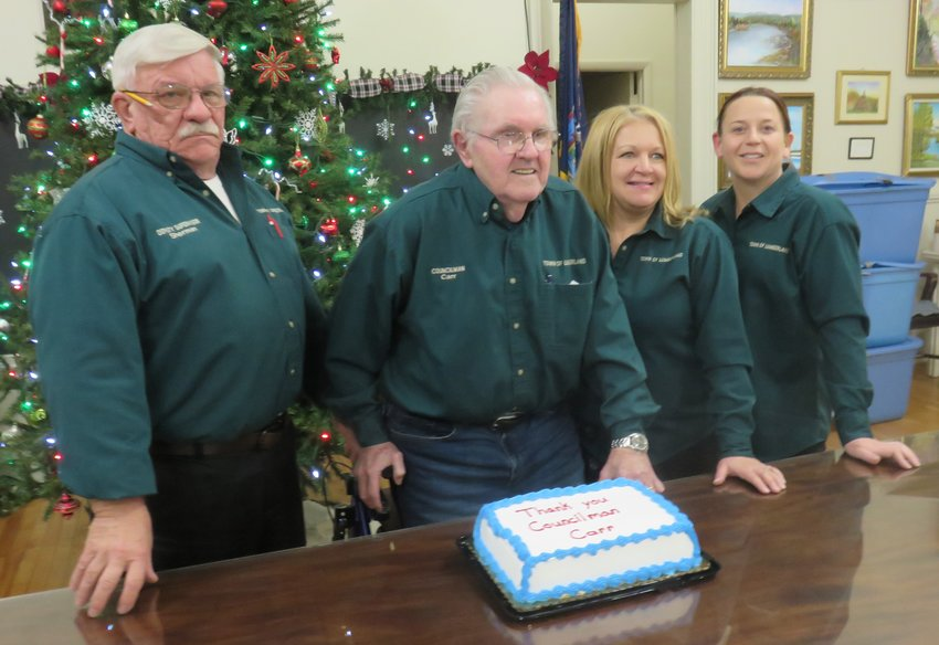 Pictured around a congratulatory cake at Lumberland Councilman Joe Carr's last regular monthly town board meeting after 18 years, are deputy supervisor/councilman Leigh Sherman, left,  councilman Joe Carr, supervisor Jenny Mellan and councilwoman Zoriana Gingold. Councilman James Akt did not attend.