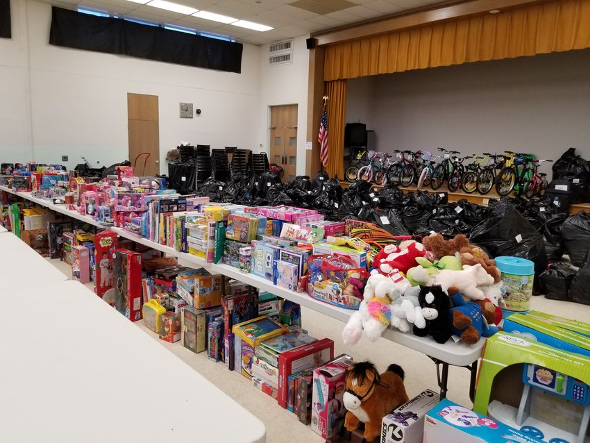 With the help of the entire community, the Children's Christmas Bureau offers quite an array of presents on distribution day.