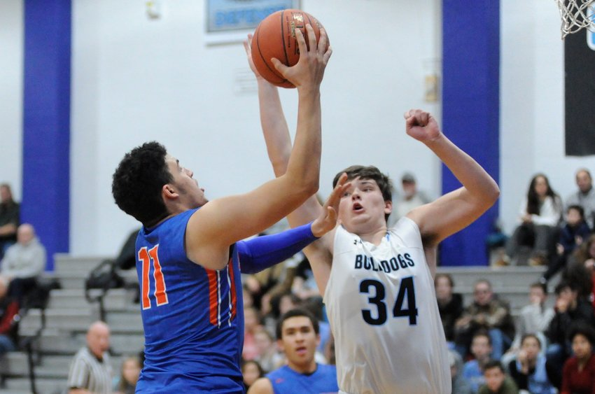 Two-hand symphony. Chester's Kevin Stein goes to the glass against Sullivan West's Cody Powell. Stein posted 27 points to lead his team to victory.