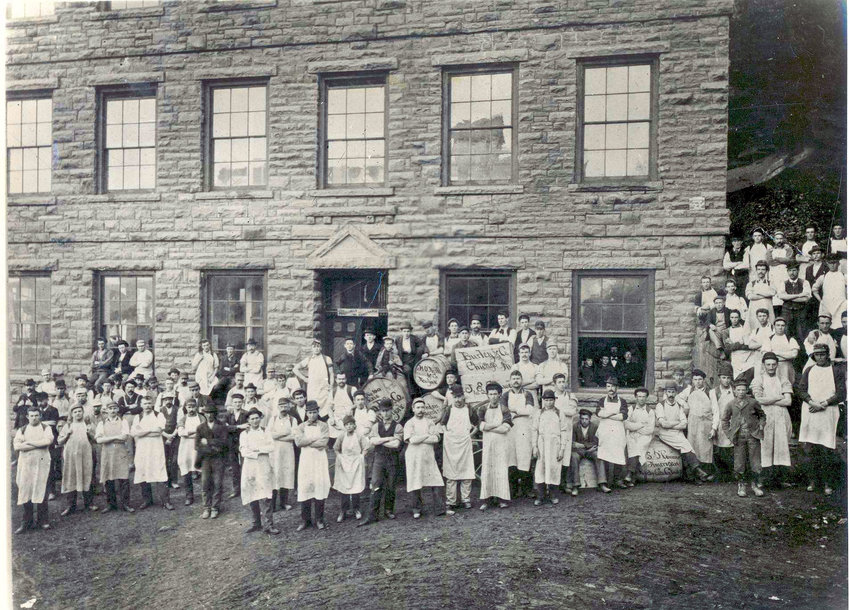 Some of John S. O'Connor's employees outside of the glass-cutting factory in Hawley, PA.