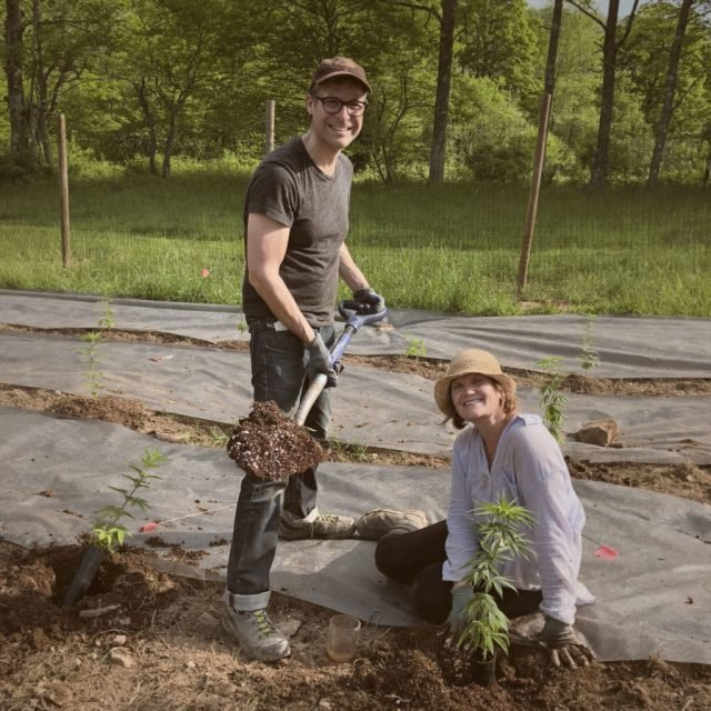 Andrew Rosner, left, and his partner Kristen Hallet work on their farm, HR Botanicals in Long Eddy, NY.