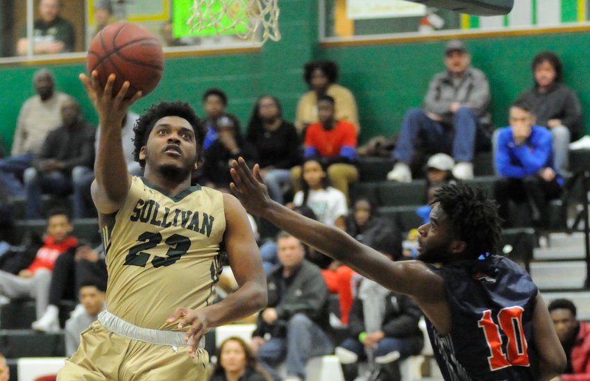 MVP bound. Sullivan's Darius Lee goes to the net against Orange's Mitchell Kernizan in the men's championship game. Darius garnered the Region XV, Division II Most Valuable Player award and was also named Region XV, Division II Player of the Year.